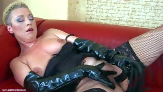Mature lady bettany wears black fetish outfit..