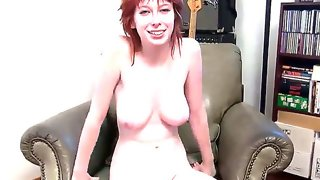 Redhead slut zoey demonstrates her big natural..