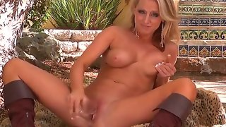 Blondie in boots melissa xoxo  shows off her fun..