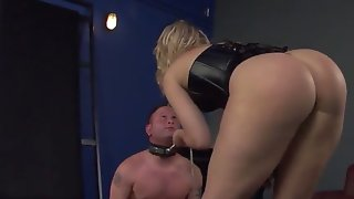 Mean looking blonde dominatrix in hot