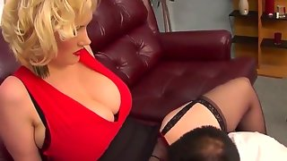 Smoking hot chubby busty dominatrix in