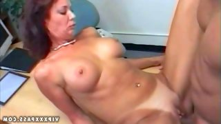 Tanned cheating redhead milf with fake tits and..